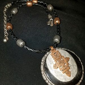 Beautiful Chico's statement pendant with leather.